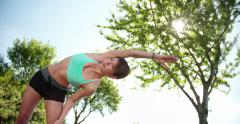 Girl Stretching on the Road Stock Footage