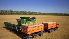Stock Video Footage aerial view combines harvesting - stock footage