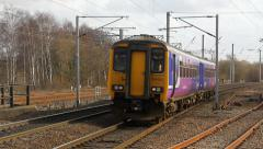 Class 156 dmu approaching Wigan North Western northbound Stock Footage