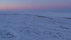 An aerial over the frozen arctic region of Hudson bay, Canada at sunset or Stock Footage