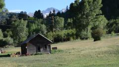 Ranch house camera pan- mountains Stock Footage