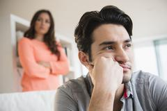 Couple arguing in living room Stock Photos