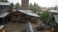 Torrential rain in rainy season downpour in village - stock footage
