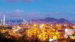 Timelapse video of cargo terminal in Hong Kong from day to night, zooming in Stock Footage