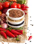 Red, black and unpolished organic rice and vegetables Stock Photos