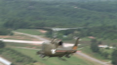 Huey gunship flies away Stock Footage