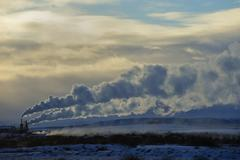 Distant power plant in arctic landscape Stock Photos