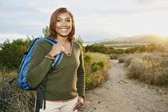 Black woman smiling on rural hillside Stock Photos