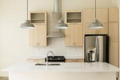 Light fixtures in modern kitchen Stock Photos