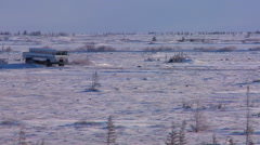 An arctic crawler tundra buggy moves across the frozen expanse of Hudson bay, - stock footage