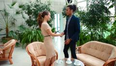 Business handshake of young creative people of different races - stock footage