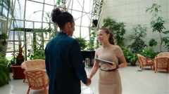 Handshake of young business people of different sex and racial origin - stock footage