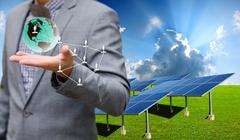 Stock Illustration of sustainable energy concept, solar farm with businessman carry virtual world