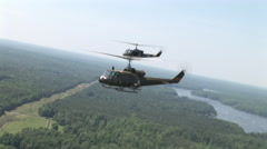 Huey helicopters fly in formation Stock Footage