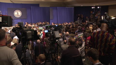 Media at political rally wide shot interior Stock Footage
