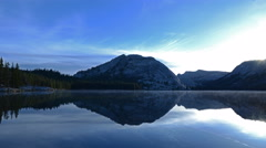 4K Time Lapse of Sunrise at Reflective Lake in Yosemite -Tilt Down- Stock Footage