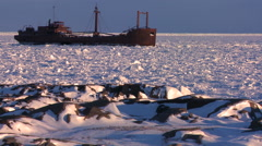 A ship sits trapped in the ice of frozen Hudson Bay, Churchill, Manitoba, - stock footage