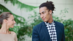 Meeting of two young business people in a modern office Stock Footage