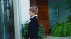 A little boy came up to two adults and business people shaking hands with them Stock Footage