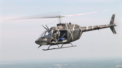 Kiowa OH-58 helicopter on a mission Stock Footage