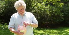Older Man Saving money, Pig Animal Money Box Stock Footage