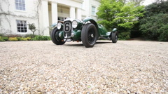 Lagonda Classic Racing Car with Country Home Stock Footage