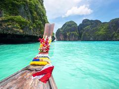 Longtail Boat in Maya Bay, Ko Phi Phi, Thailand - stock photo