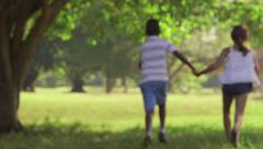 1of18 Black boy, white girl, children holding hands Stock Footage