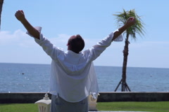Man rising hands and feeling free, slow motion shot - stock footage