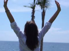 Woman rising hands and feeling free, slow motion shot at 240fps Stock Footage