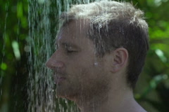 Man getting wet in the shower, slow motion shot at 240fps Stock Footage
