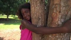 2of18 Black school girl hugging tree in park, ecology, people Stock Footage