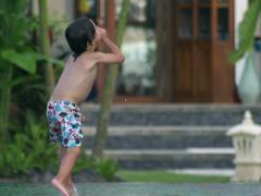 Boy nosediving in the swimming pool, slow motion shot at 240fps Stock Footage