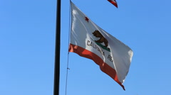 State of California Flag Flies Against Blue Sky Stock Footage