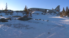 A crashed plane sits on a frozen snowy mountainside in the Arctic. Stock Footage