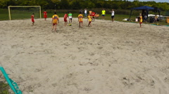 Football kids playing game in the sand ,kids enjoy in sport Stock Footage