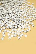 Silver stars on gold with copy space Stock Photos