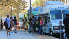 Row of Food Trucks in Miracle Mile Los Angeles Stock Footage