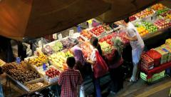 Time lapse of customers at fruit and veggie stall at Chinatown night market Stock Footage