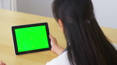 Asian doctor talking to tablet with green screen - stock footage