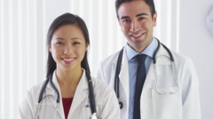 Portrait of two doctors smiling Stock Footage