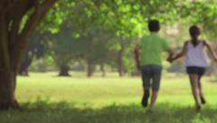8of18 Happy children, little boy and girl, couple holding hands Stock Footage