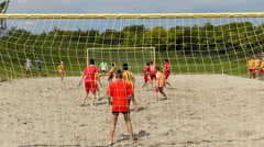Kids playing game in the sand ,kids enjoy in sport Stock Footage