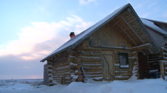 A log cabin in the snow. Stock Footage