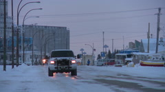 Vehicles travel along an icy snowy road at Churchill, Manitoba, Canada, Hudson - stock footage