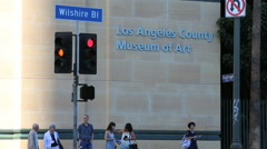 Los Angeles Museum of Contemporary Art Sign with People and Cars Stock Footage