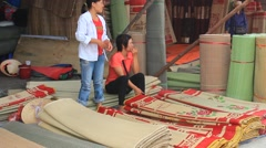 People at Market selling bed mats,  Asia Stock Footage