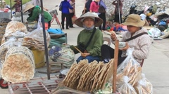 woman selling rice cakes in market,  Asia - stock footage