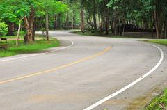 Curve road in a green peaceful park Stock Photos