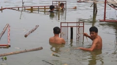 artisans make water stage for water puppet show, a unique art of Asia - stock footage